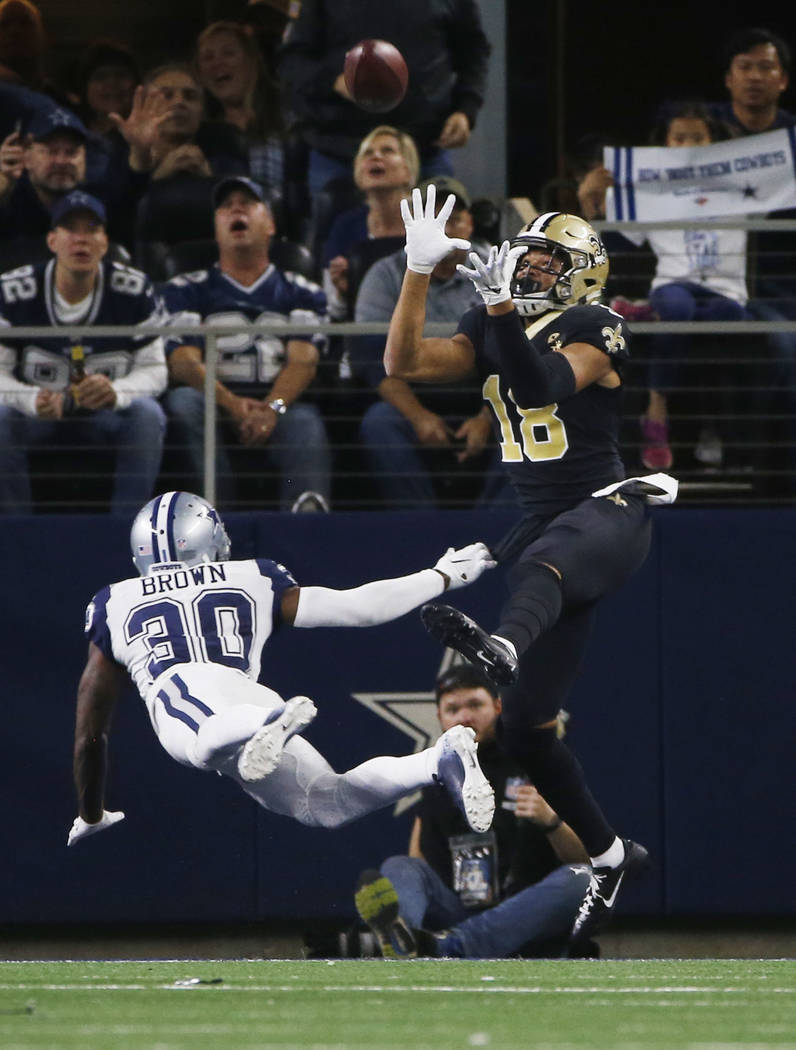 New Orleans Saints wide receiver Keith Kirkwood (18) makes a touchdown catch over Dallas Cowboys cornerback Anthony Brown (30) during the second half of an NFL football game, in Arlington, Texas, ...