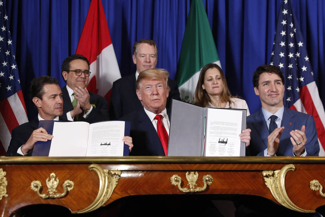 President Donald Trump, Canada's Prime Minister Justin Trudeau, right, and Mexico's President Enrique Pena Neto, left, participate in the USMCA signing ceremony, Friday, Nov. 30, 2018 in Buenos Ai ...