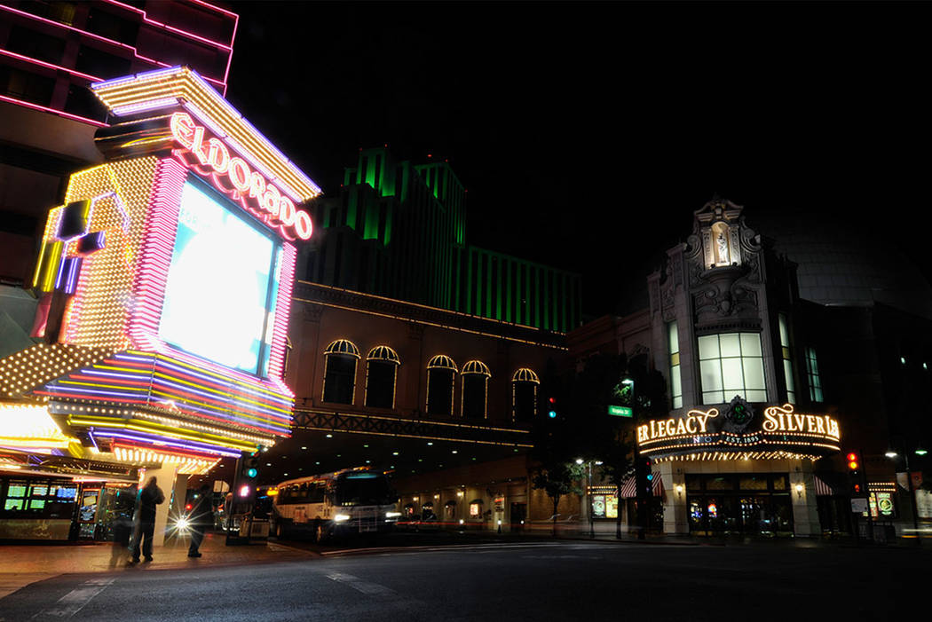 Pedestrians wait to cross the street from the Eldorado Hotel and Casino to the Silver Legacy Resort and Casino in Downtown Reno, in 2008. (Las Vegas Review-Journal)