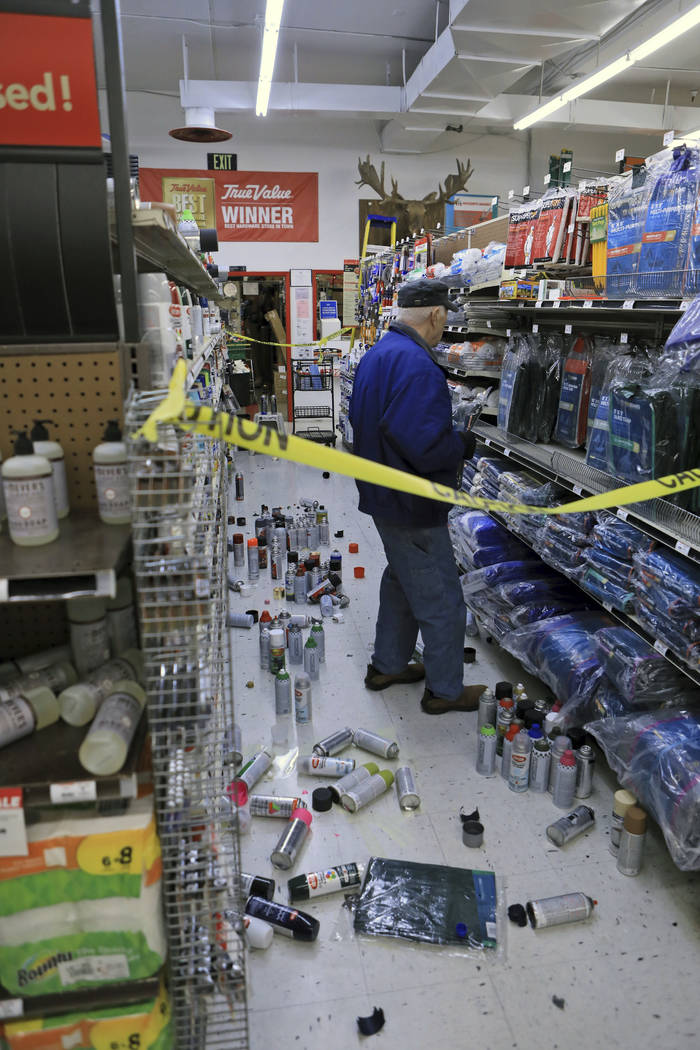 A customer at Anchorage True Value hardware store shops in the partially cleaned-up paint aisle after an earthquake Friday morning, Nov. 30, 2018, in Anchorage, Alaska. Tim Craig, owner of the sou ...