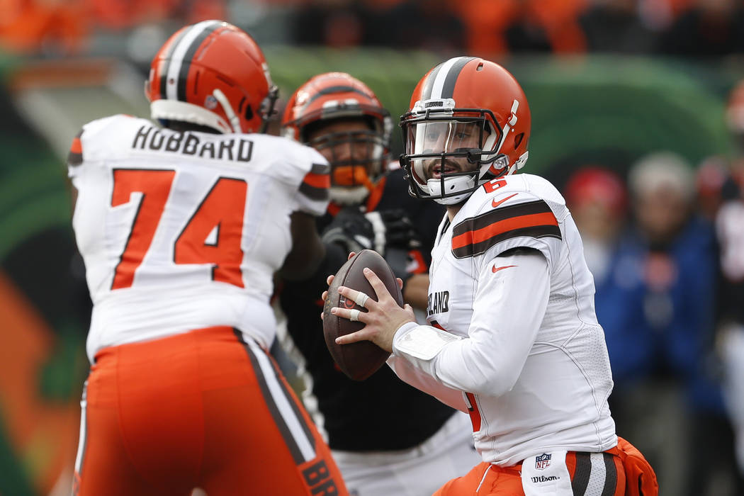 Cleveland Browns quarterback Baker Mayfield looks to pass in the first half of an NFL football game against the Cincinnati Bengals, Sunday, Nov. 25, 2018, in Cincinnati. (AP Photo/Gary Landers)