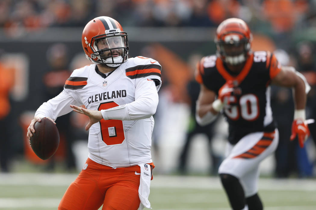 Cleveland Browns quarterback Baker Mayfield runs the ball in the first half of an NFL football game against the Cincinnati Bengals, Sunday, Nov. 25, 2018, in Cincinnati. (AP Photo/Gary Landers)