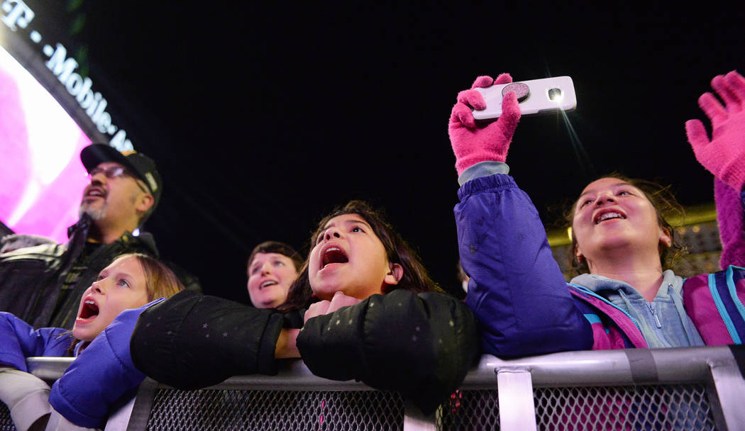 Attendees cheer for Santa Claus at a tree-lighting ceremony as a part of The Holiday Experience at The Park in Las Vegas, Thursday, Nov. 29, 2018. Caroline Brehman/Las Vegas Review-Journal