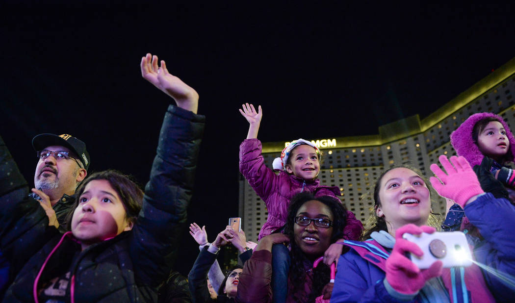 Attendees wave to Santa Claus at a tree-lighting ceremony as a part of The Holiday Experience at The Park in Las Vegas, Thursday, Nov. 29, 2018. Caroline Brehman/Las Vegas Review-Journal