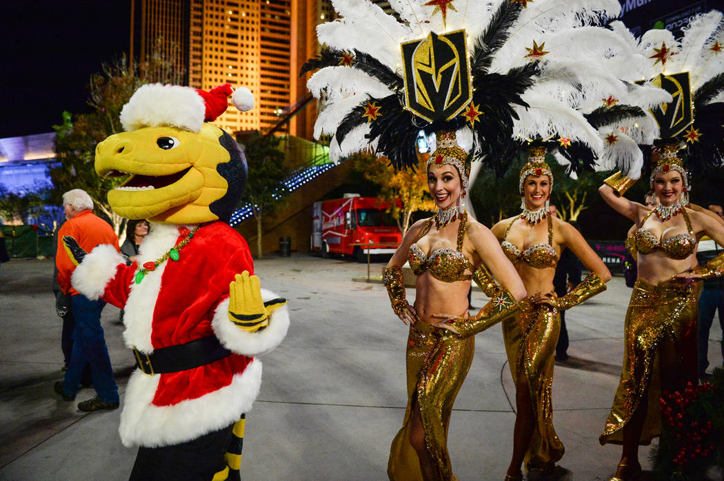 Golden Knights mascot Chance walks with showgirls at a tree-lighting ceremony as a part of The Holiday Experience at The Park in Las Vegas, Thursday, Nov. 29, 2018. Caroline Brehman/Las Vegas Revi ...