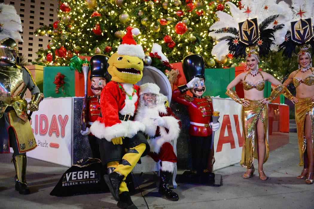 Golden Knights mascot Chance sits on Santa Claus' lap at a tree-lighting ceremony as a part of The Holiday Experience at The Park in Las Vegas, Thursday, Nov. 29, 2018. Caroline Brehman/Las Vegas ...