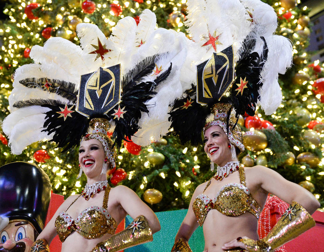 Golden Knights Showgirls stand next to Santa Claus at a tree-lighting ceremony as a part of The Holiday Experience at The Park in Las Vegas, Thursday, Nov. 29, 2018. Caroline Brehman/Las Vegas Rev ...