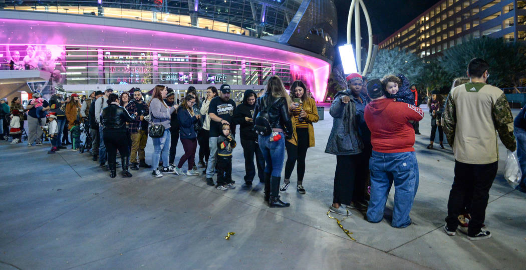 Attendees wait in line to take a photograph with Santa Claus at a tree-lighting ceremony as a part of The Holiday Experience at The Park in Las Vegas, Thursday, Nov. 29, 2018. Caroline Brehman/Las ...