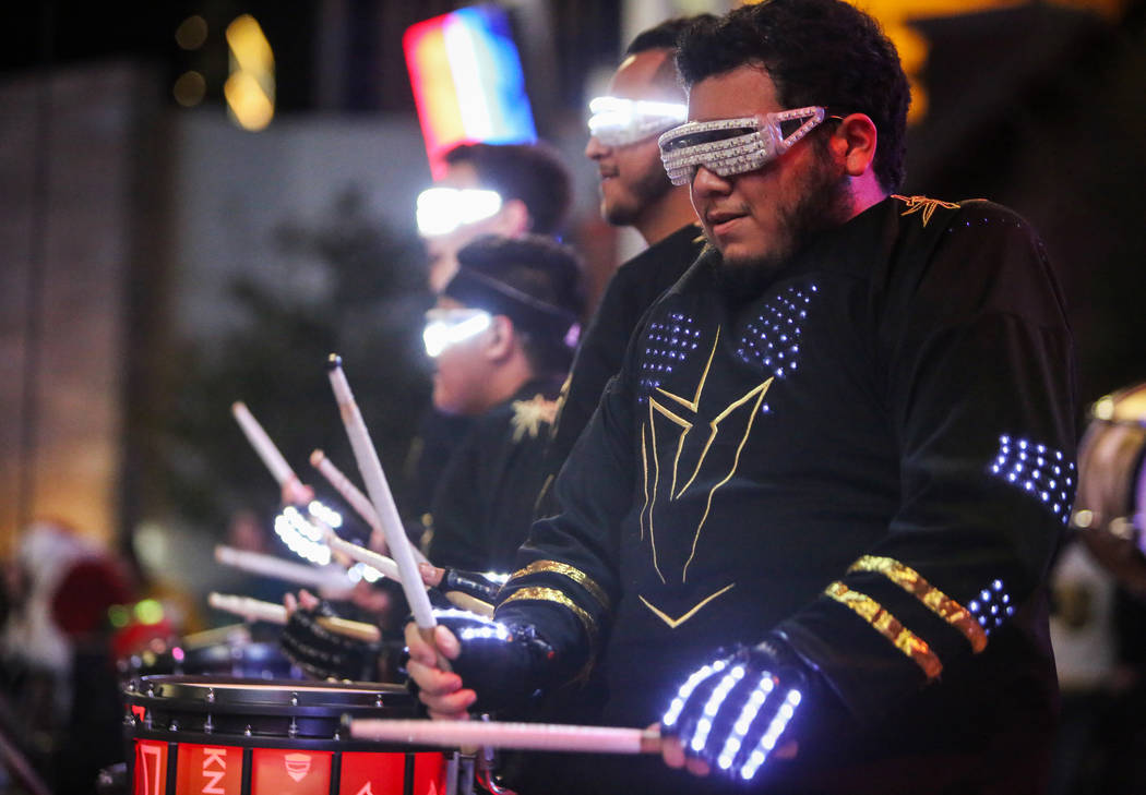 Golden Knights drum line performs at a tree-lighting ceremony as a part of The Holiday Experience at The Park in Las Vegas, Thursday, Nov. 29, 2018. Caroline Brehman/Las Vegas Review-Journal