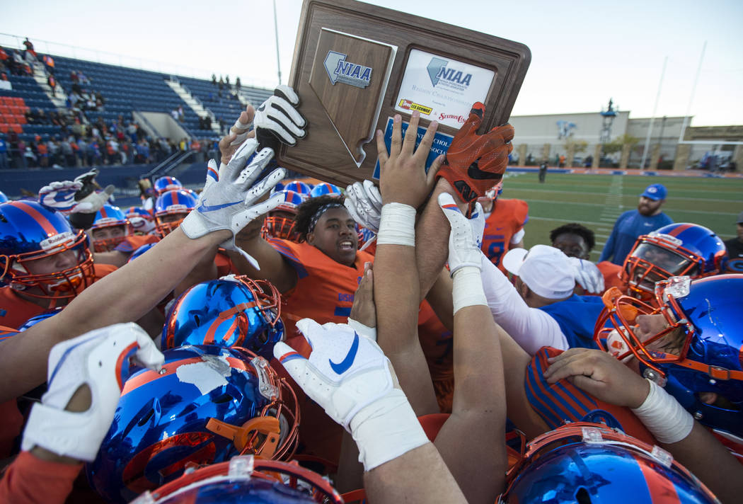 Bishop Gorman celebrates its 42-28 victory over Liberty High School following the NIAA 4A Desert Region championship game at Bishop Gorman High School in Las Vegas on Saturday, Nov. 24, 2018. Rich ...