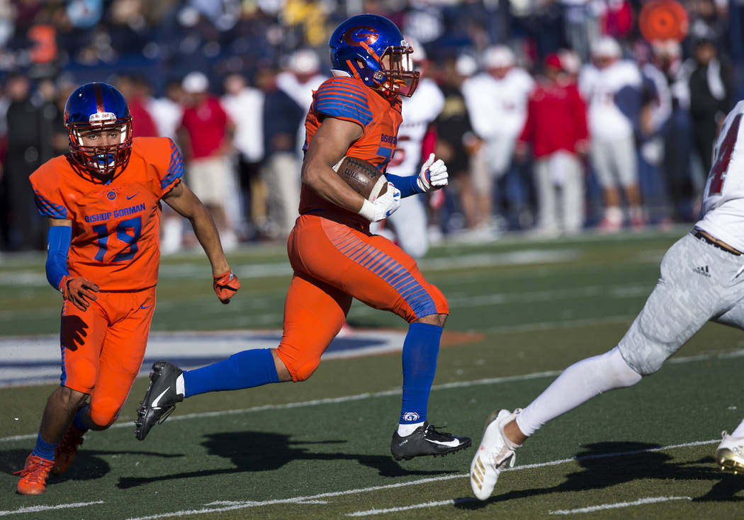 Bishop Gorman running back Amod Cianelli (23), center, carries the ball for a touchdown against Liberty during the first half of the NIAA 4A Desert Region championship game at Bishop Gorman High S ...