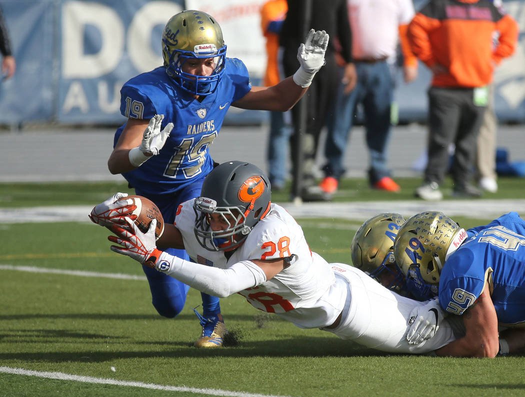 Bishop Gorman's Amod Cianelli dives for the goal line during the first half of the NIAA 4A state championship football game in Reno, Nev., on Saturday, Dec. 2, 2017. Cathleen Allison/Las Ve ...