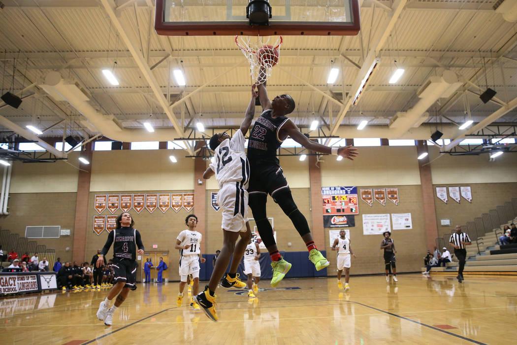 Cimarron-Memorial's Makhi Walker (22) drunks the ball against Democracy Prep's Elijah Barnes (22) in their basketball game at Legacy High School in North Las Vegas, Friday, Nov. 30, 2018. Erik Ver ...