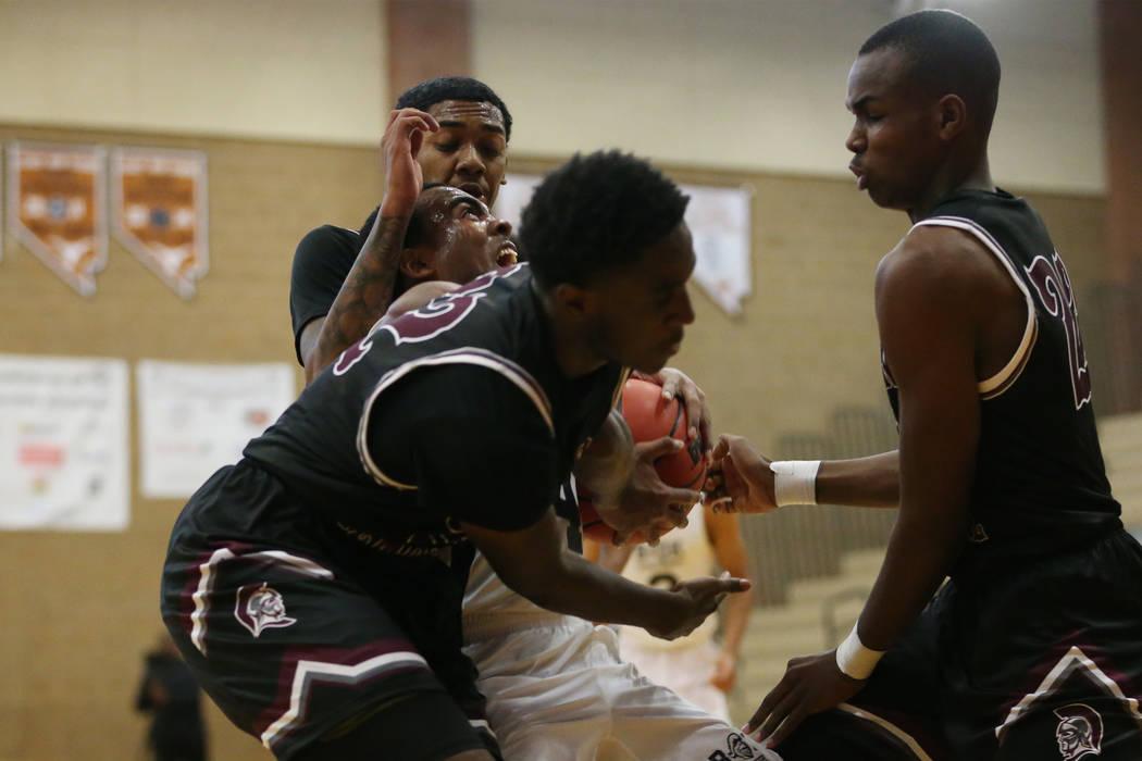 Democracy Prep's Daniel Plumer (4) is triple-teamed against Cimarron-Memorial in their basketball game at Legacy High School in North Las Vegas, Friday, Nov. 30, 2018. Erik Verduzco Las Vegas Revi ...