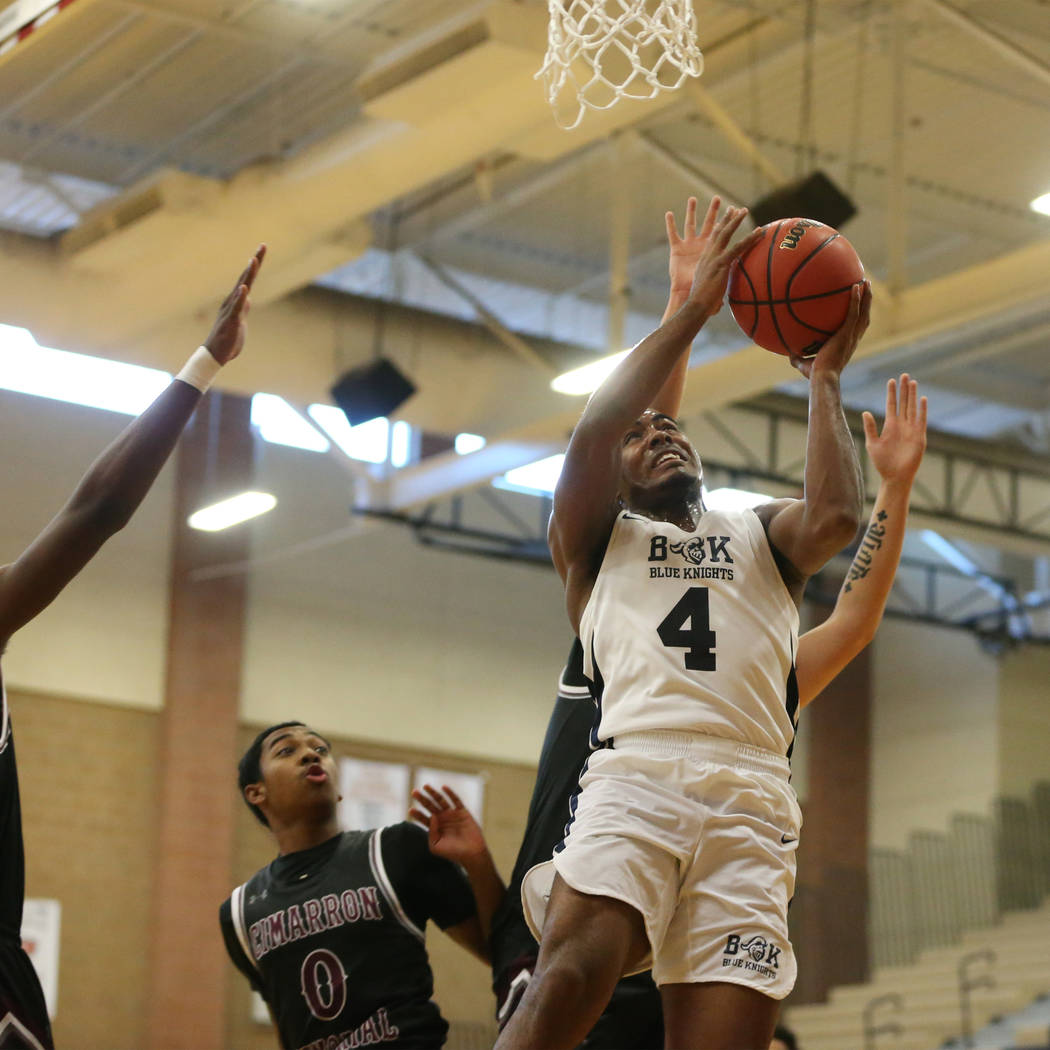 Democracy Prep's Daniel Plumer (4) goes up for a shot against Cimarron-Memorial in their basketball game at Legacy High School in North Las Vegas, Friday, Nov. 30, 2018. Erik Verduzco Las Vegas Re ...