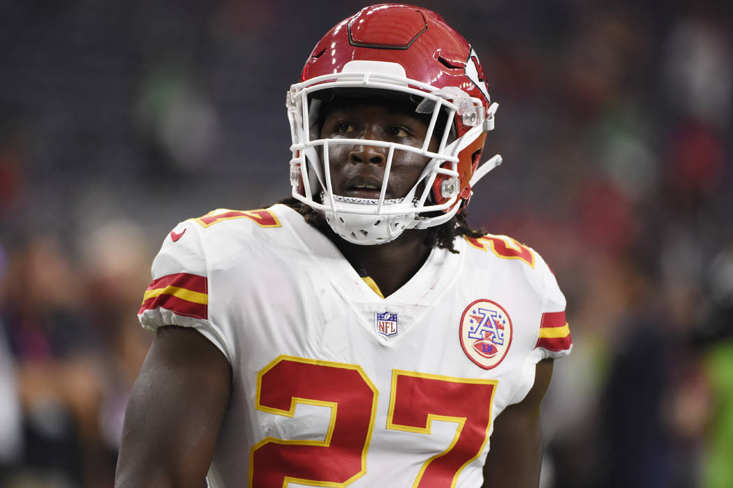 In this Oct. 8, 2017, file photo, Kansas City Chiefs running back Kareem Hunt warms up for the team's NFL football game against the Houston Texans in Houston. A person with knowledge of the move t ...