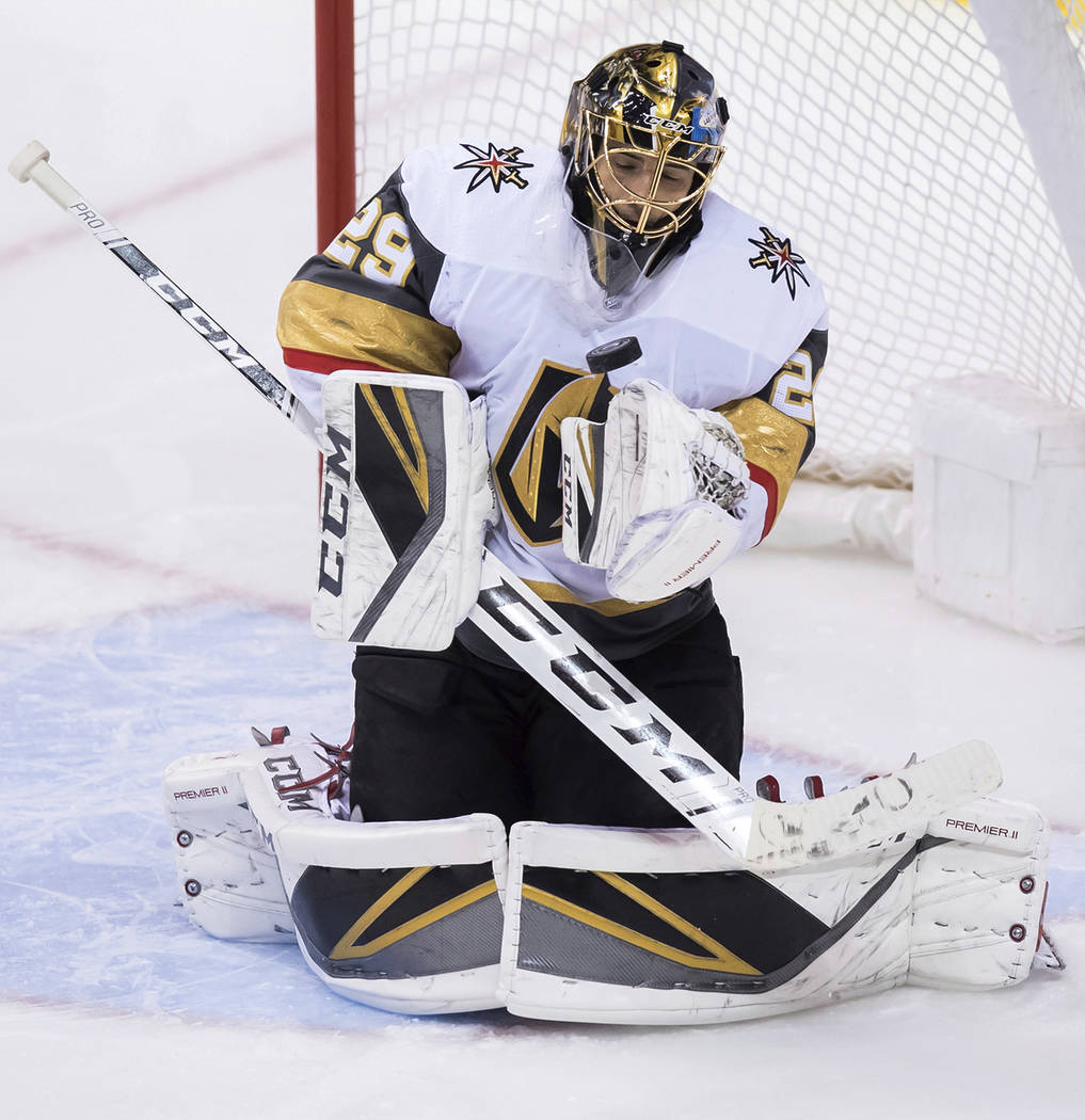 Vegas Golden Knights goalie Marc-Andre Fleury makes a save against the Vancouver Canucks during the second period of an NHL hockey game Thursday, Nov. 29, 2018, in Vancouver, British Columbia. (Da ...