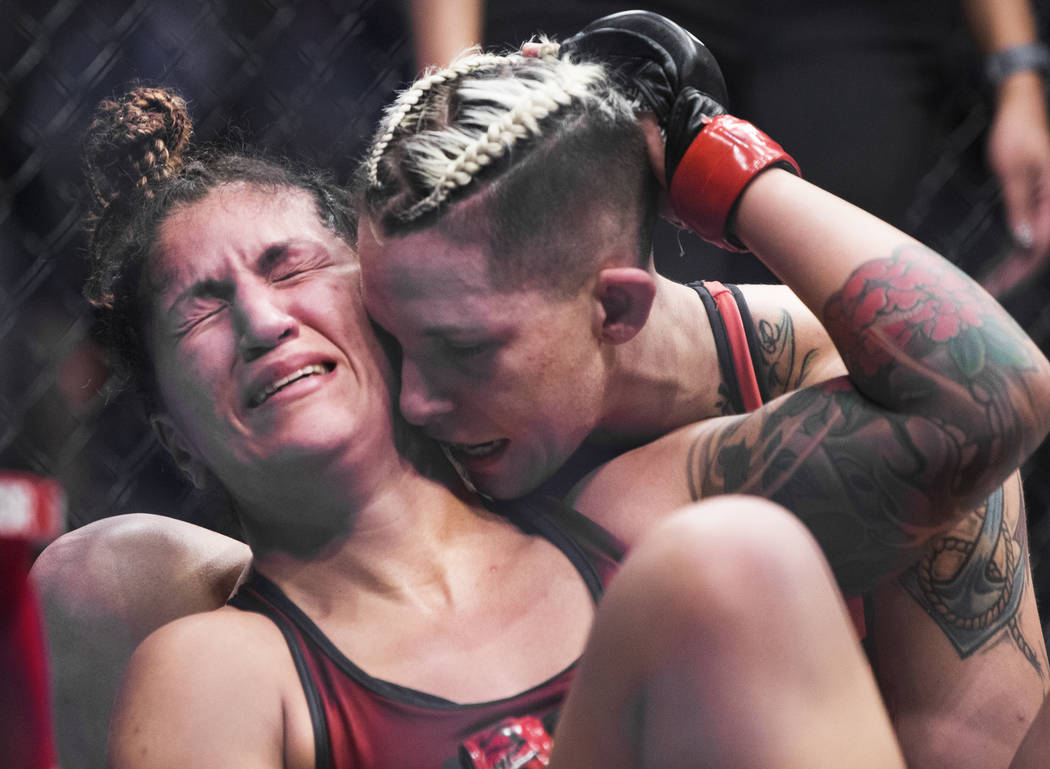 """Pannie Kianzad, left, is comforted by Macy Chiasson after Chiasson submitted her in the second round of """"The Ultimate Fighter"""" Season 28 Finale on Friday, Nov. 30, 2018, at The Pearl ..."""