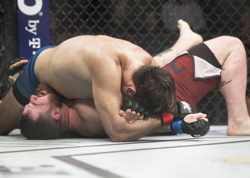 """Juan Espino, top, submits Justin Frazier in the first round during """"The Ultimate Fighter"""" Season 28 Finale on Friday, Nov. 30, 2018, at The Pearl, at Palms, in Las Vegas. Benjamin H ..."""
