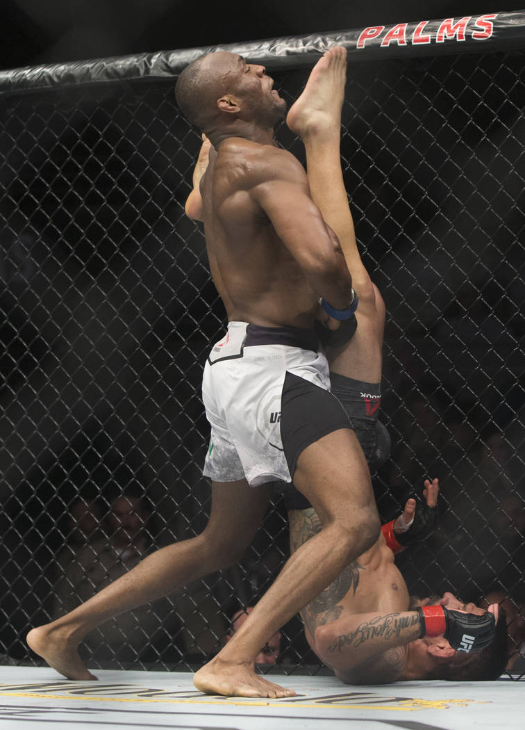 """Rafael dos Anjos, bottom, lands a kick against Kamaru Usman in the first round during """"The Ultimate Fighter"""" Season 28 Finale on Friday, Nov. 30, 2018, at The Pearl, at Palms, in Las Vegas. Usman ..."""