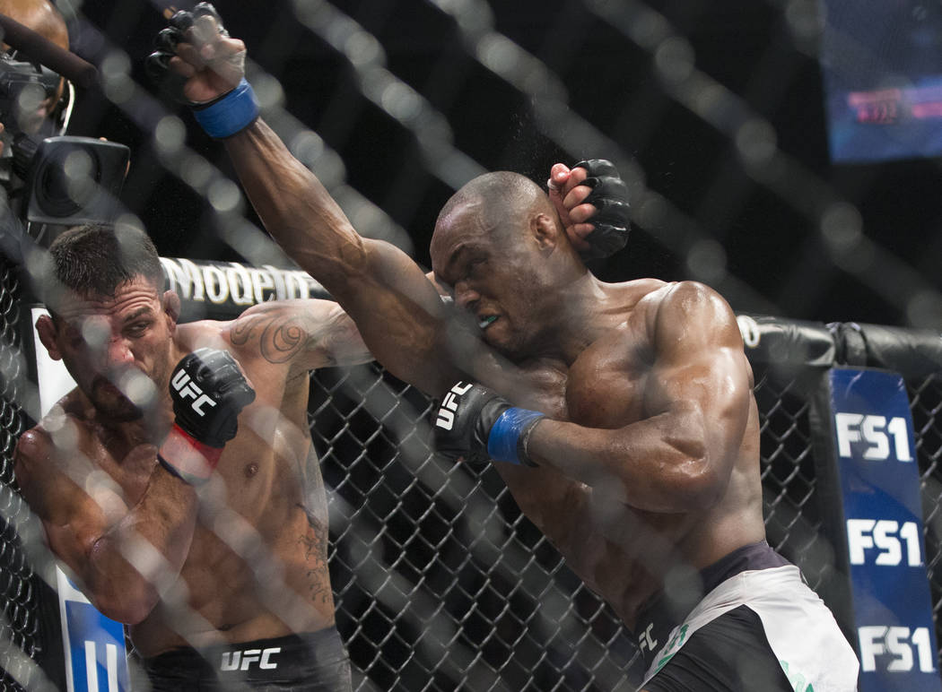 """Kamaru Usman, right, throws an uppercut against Rafael dos Anjos in the fifth round during """"The Ultimate Fighter"""" Season 28 Finale on Friday, Nov. 30, 2018, at The Pearl, at Palms, in Las Vegas. U ..."""