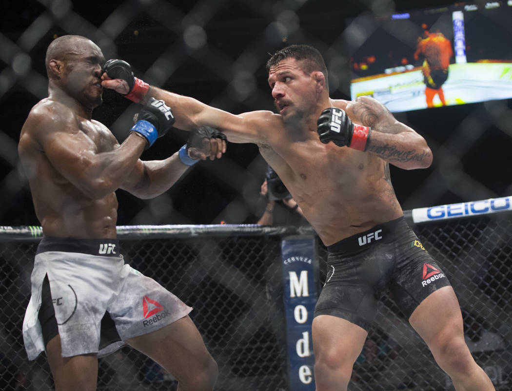 """Rafael dos Anjos, right, lands a right hook against Kamaru Usman in the third round during """"The Ultimate Fighter"""" Season 28 Finale on Friday, Nov. 30, 2018, at The Pearl, at Palms, in Las Vegas. U ..."""
