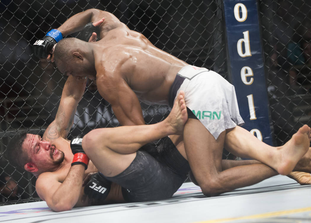 """Kamaru Usman, right, works ground and pound against Rafael dos Anjos in the fifth round during """"The Ultimate Fighter"""" Season 28 Finale on Friday, Nov. 30, 2018, at The Pearl, at Palms, in Las Vega ..."""