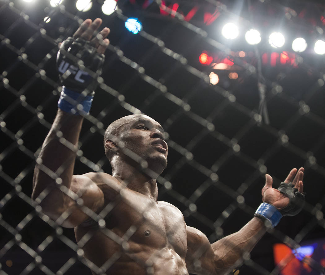 """Kamaru Usman celebrates after defeating Rafael dos Anjos in a five round decision during """"The Ultimate Fighter"""" Season 28 Finale on Friday, Nov. 30, 2018, at The Pearl, at Palms, in Las Vegas. Ben ..."""