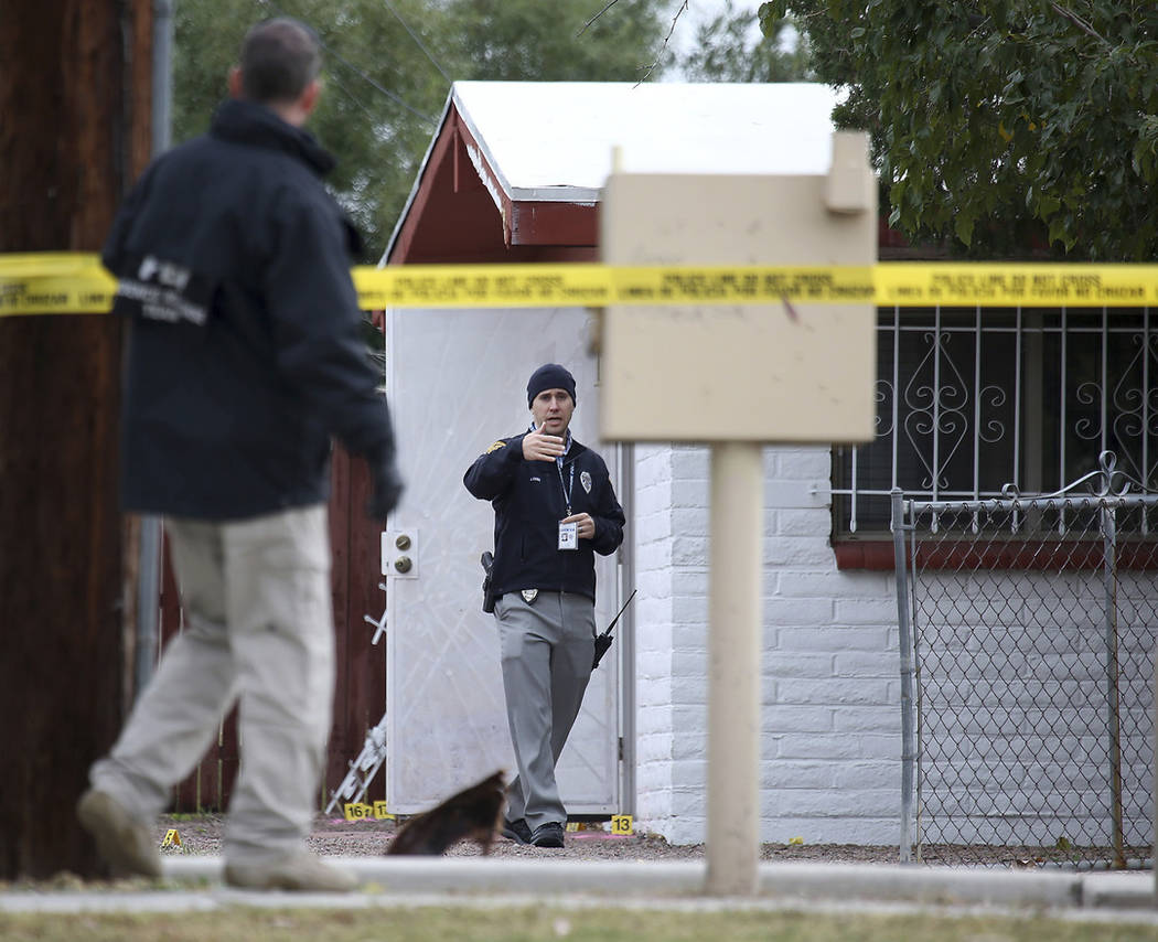 Law enforcement personnel continue their investigation at the scene following a shooting Friday, Nov. 30, 2018, in Tucson, Ariz. (Ron Medvescek/Arizona Daily Star via AP)
