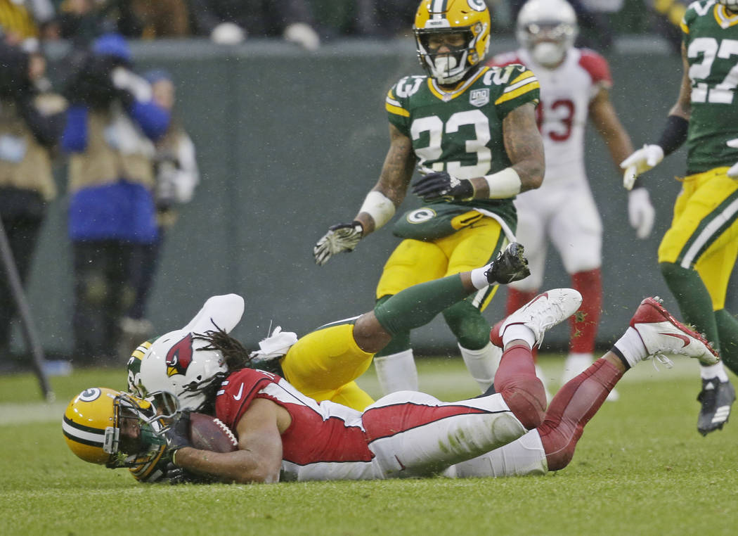 Arizona Cardinals wide receiver Larry Fitzgerald makes a diving catch for a first down late in the second half of an NFL football game against the Green Bay Packers Sunday, Dec. 2, 2018, in Green ...