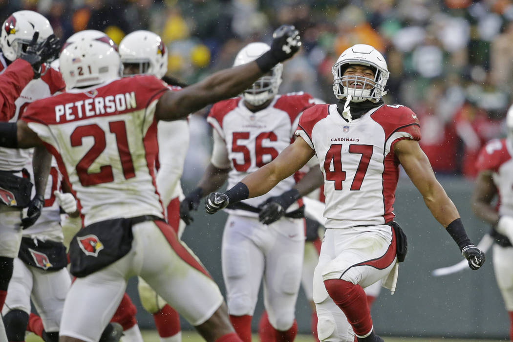 Arizona Cardinals players celebrate a win after a last minute missed field goal by the Green Bay Packers during the second half of an NFL football game Sunday, Dec. 2, 2018, in Green Bay, Wis. Ari ...