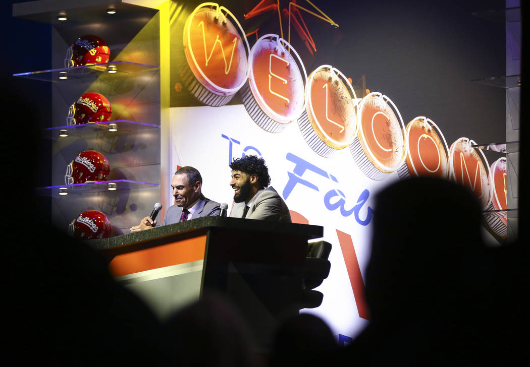 Arizona State head coach Herm Edwards, left, speaks alongside quarterback Manny Wilkins during the Las Vegas Bowl kickoff luncheon at The Joint at the Hard Rock Hotel in Las Vegas on Friday, Dec. ...