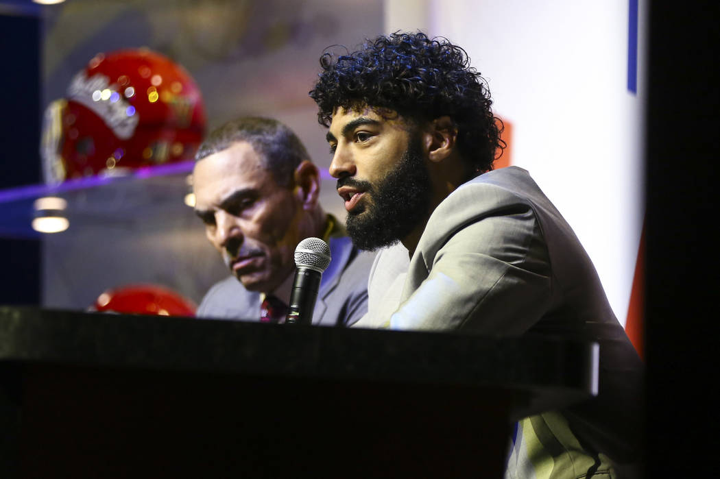 Arizona State quarterback Manny Wilkins speaks alongside head coach Herm Edwards during the Las Vegas Bowl kickoff luncheon at The Joint at the Hard Rock Hotel in Las Vegas on Friday, Dec. 14, 201 ...