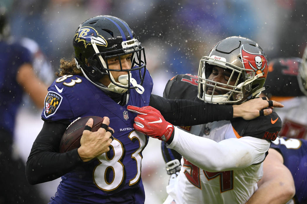 Baltimore Ravens wide receiver Willie Snead, left, rushes against Tampa Bay Buccaneers outside linebacker Lavonte David in the first half of an NFL football game, Sunday, Dec. 16, 2018, in Baltimo ...