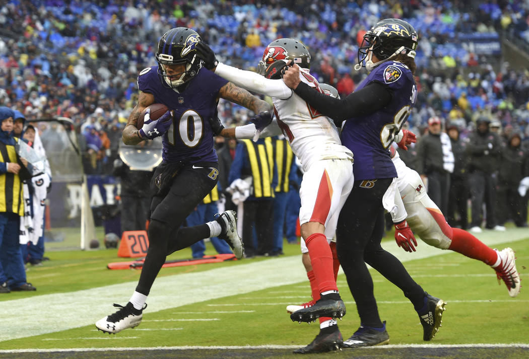 Baltimore Ravens wide receiver Chris Moore (10) scores a touchdown in the first half of an NFL football game against the Tampa Bay Buccaneers, Sunday, Dec. 16, 2018, in Baltimore. (AP Photo/Gail B ...