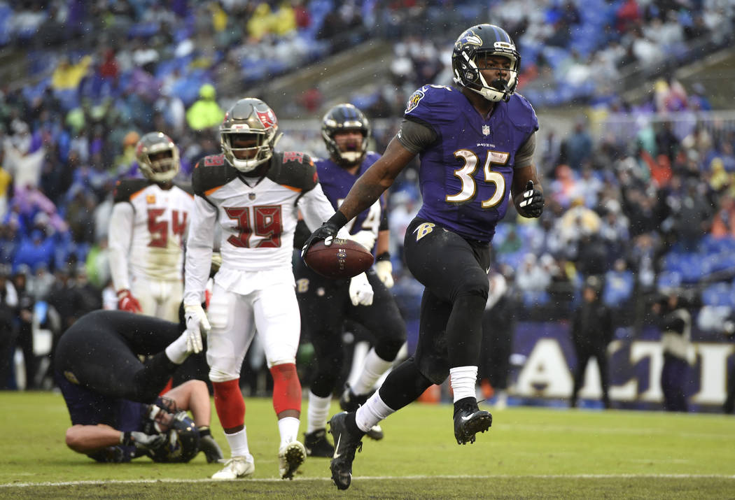 Baltimore Ravens running back Gus Edwards (35) scores a touchdown in the second half of an NFL football game against the Tampa Bay Buccaneers, Sunday, Dec. 16, 2018, in Baltimore. (AP Photo/Gail B ...