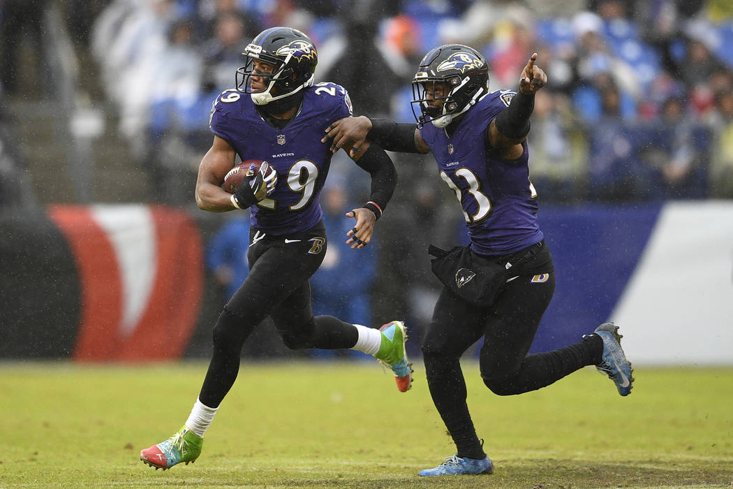 Baltimore Ravens cornerback Marlon Humphrey, left, celebrates his interception with teammate Tony Jefferson in the second half of an NFL football game against the Tampa Bay Buccaneers, Sunday, Dec ...