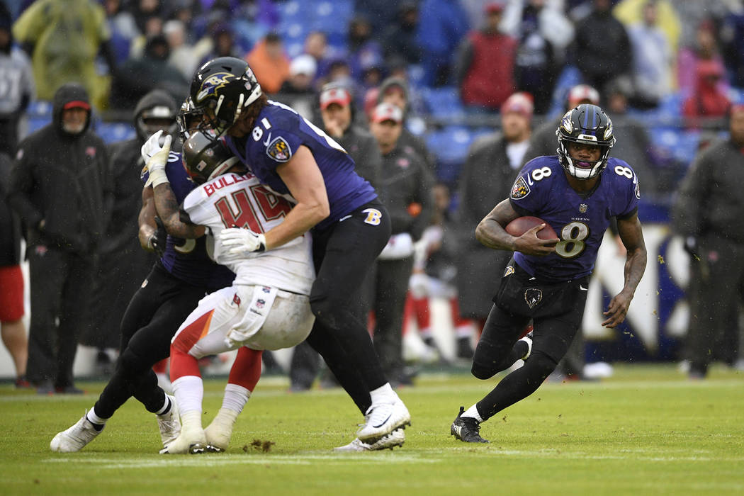 Baltimore Ravens quarterback Lamar Jackson (8) rushes the ball in the second half of an NFL football game against the Tampa Bay Buccaneers, Sunday, Dec. 16, 2018, in Baltimore. (AP Photo/Nick Wass)