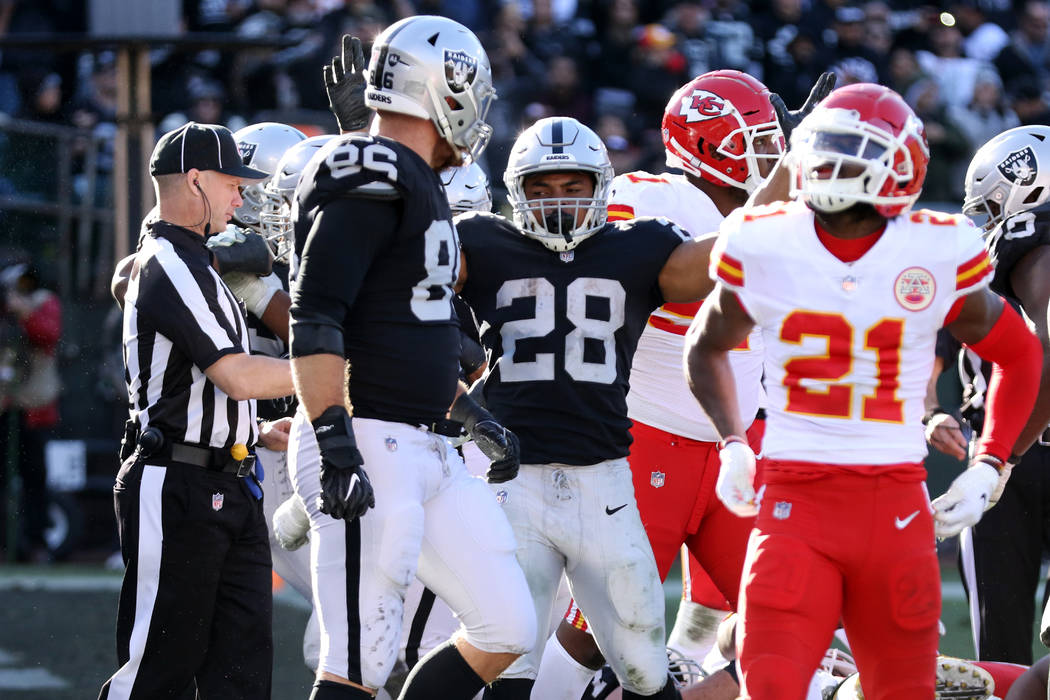 Oakland Raiders running back Doug Martin (28) celebrates his touchdown with tight end Lee Smith (86) as Kansas City Chiefs strong safety Eric Murray (21) watches the replay during the first half o ...