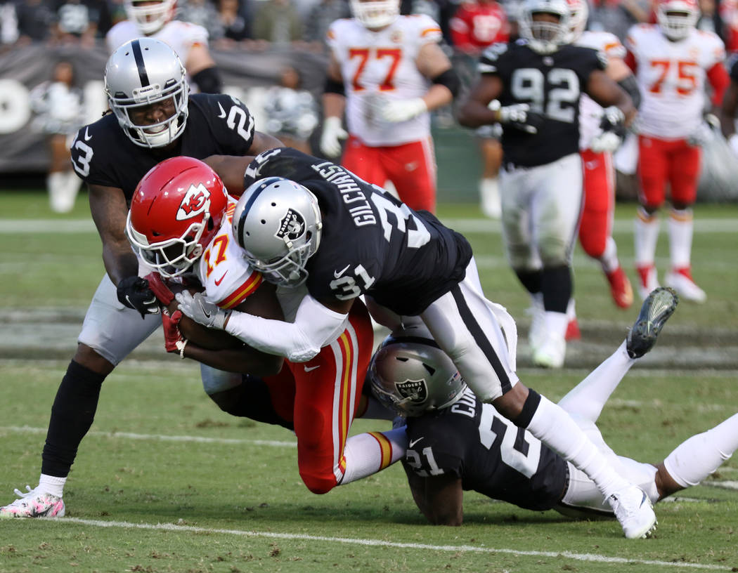 Kansas City Chiefs wide receiver Chris Conley (17) is tackled by Oakland Raiders strong safety Marcus Gilchrist (31), cornerback Gareon Conley (21) and cornerback Nick Nelson (23) during the secon ...