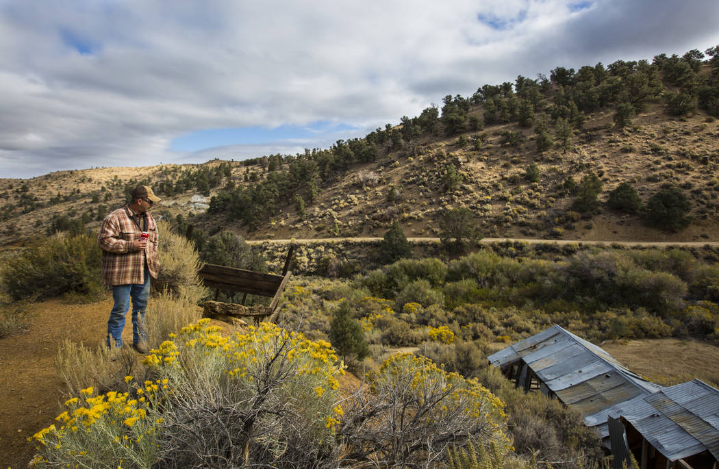 Caden Gould of Genoa walks around an area with old mines in search of vintage denim and other antiquities in south Douglas County on Thursday, Oct. 11, 2018. Mines in the area date as far back as ...