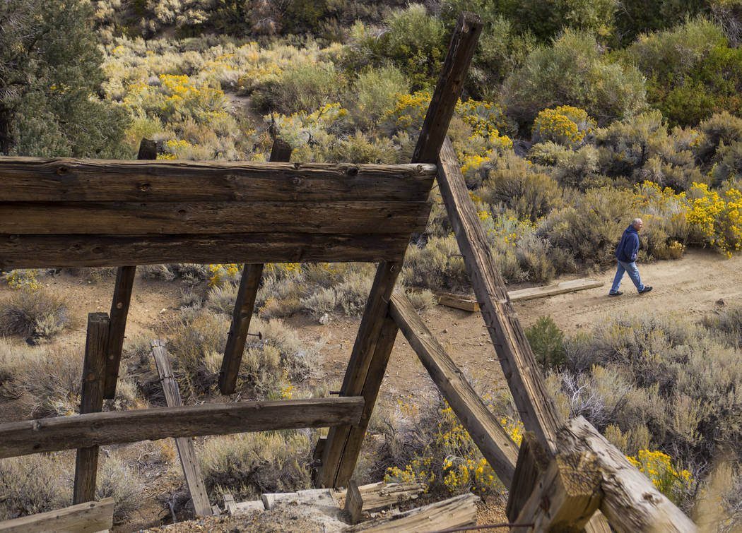 Ron Bommarito of Genoa walks around an area with old mines in search of vintage denim and other antiquities in south Douglas County on Thursday, Oct. 11, 2018. Mines in the area date as far back a ...