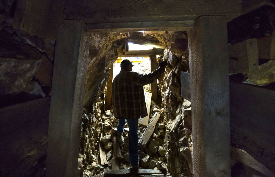 Caden Gould of Genoa searches through an old mine in search of vintage denim and other antiquities in south Douglas County on Thursday, Oct. 11, 2018. Mines in the area date as far back as the 186 ...