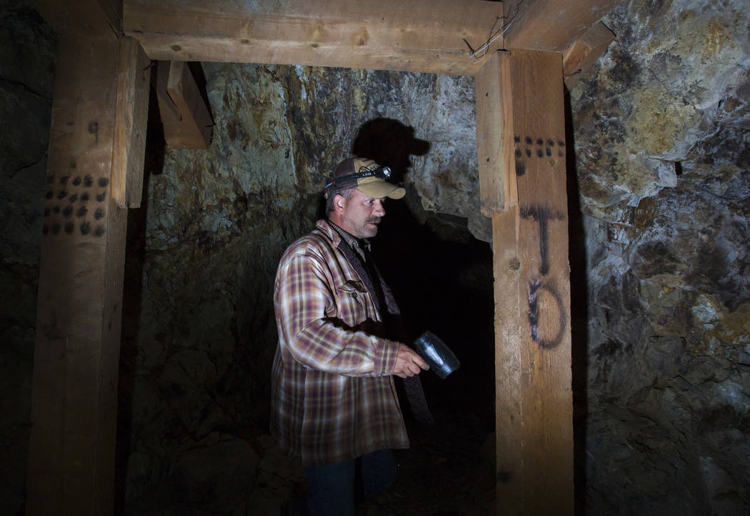 Caden Gould of Genoa looks at the markings left in an old mine in search of vintage denim and other antiquities in south Douglas County on Thursday, Oct. 11, 2018. Mines in the area date as far ba ...