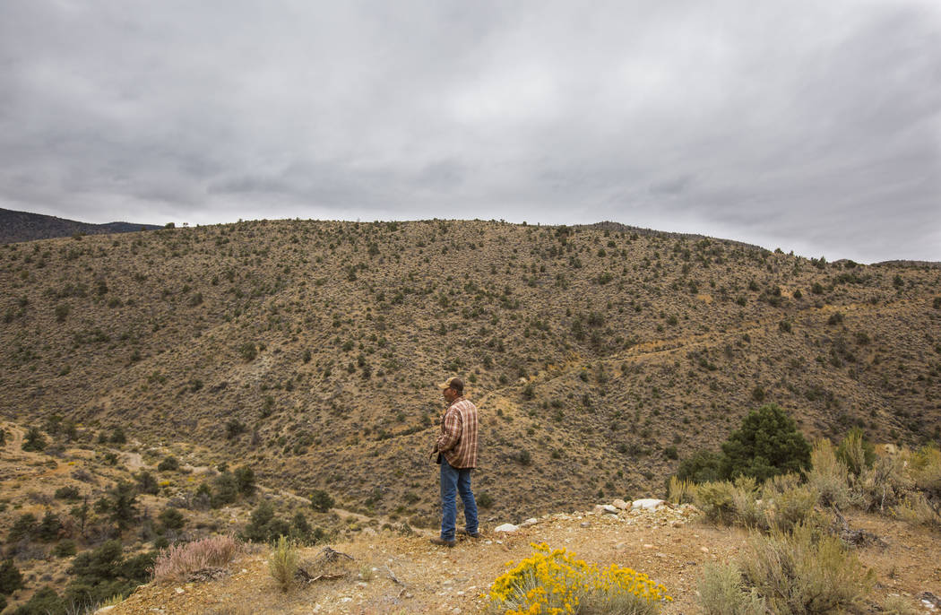 Caden Gould of Genoa looks around an area with old mines in search of vintage denim and other antiquities in south Douglas County on Thursday, Oct. 11, 2018. Mines in the area date as far back as ...
