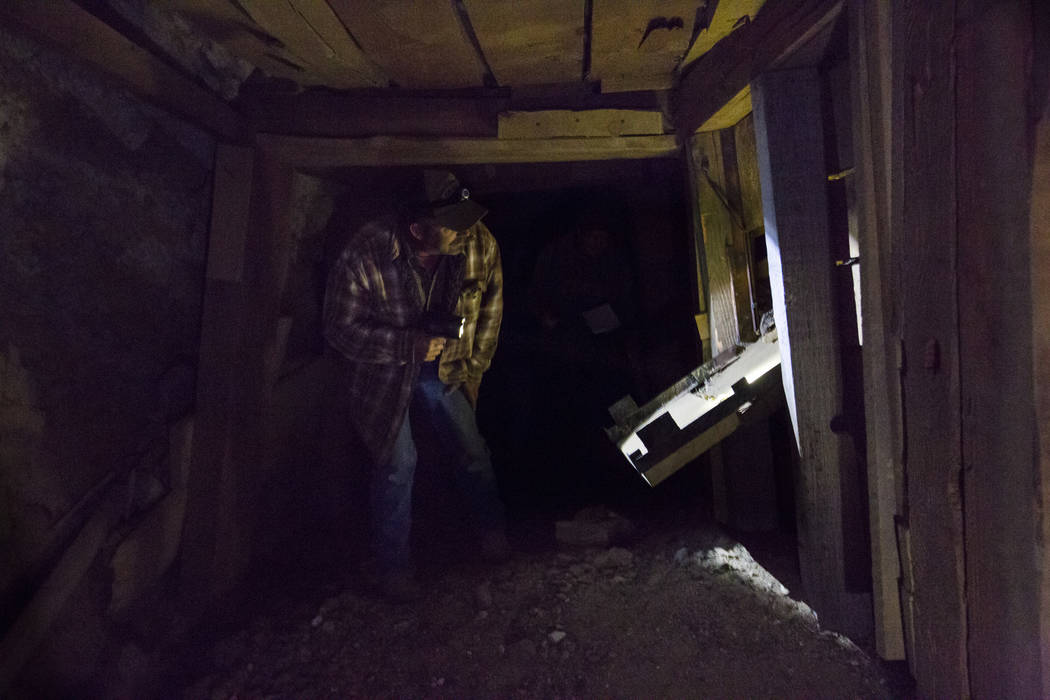 Caden Gould of Genoa looks at an ore chute while searching an old mine for vintage denim and other antiquities in south Douglas County on Thursday, Oct. 11, 2018. Mines in the area date as far bac ...