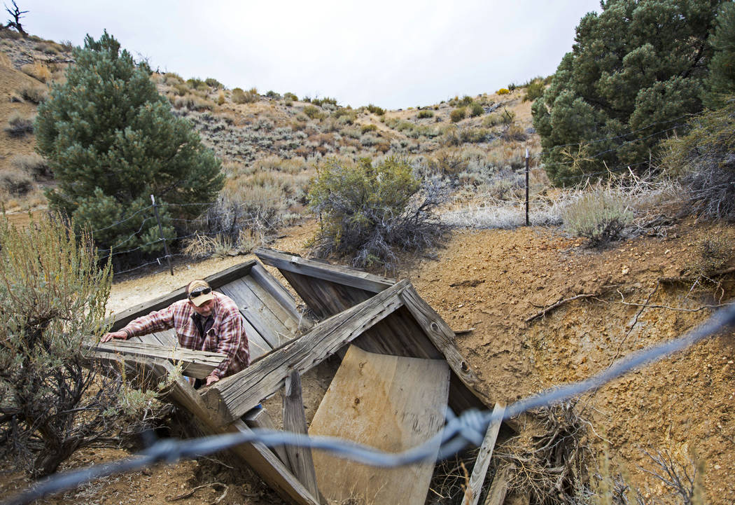 Caden Gould of Genoa looks around the portal of a mine in search of old denim and other antiquities in south Douglas County on Thursday, Oct. 11, 2018. Mines in the area date as far back as the 18 ...