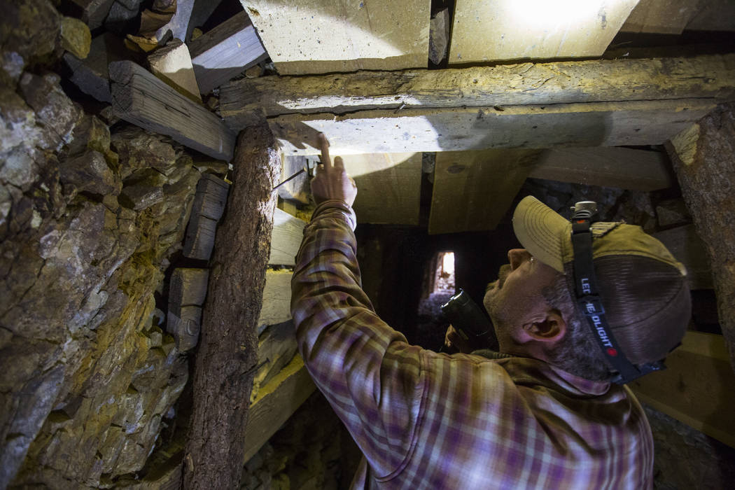 Caden Gould of Genoa looks at the old logs used insde of a mine while searching for vintage denim and other antiquities in south Douglas County on Thursday, Oct. 11, 2018. Mines in the area date a ...