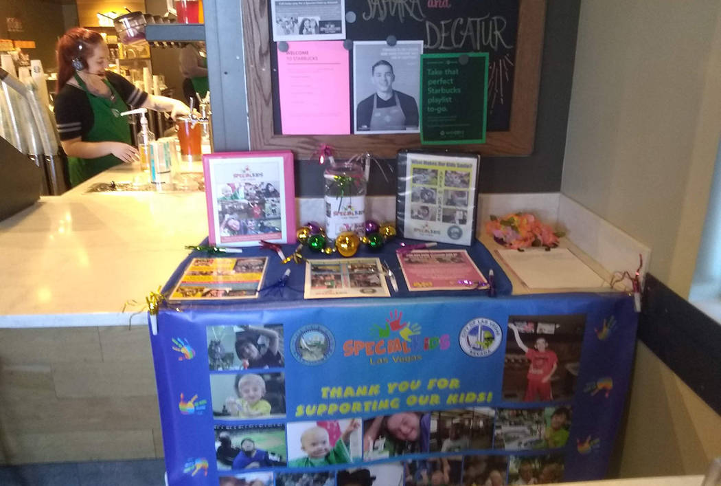 A Special Kids Las Vegas table set up at the Starbucks on Sahara Avenue and Decatur Boulevard on Sept. 14.