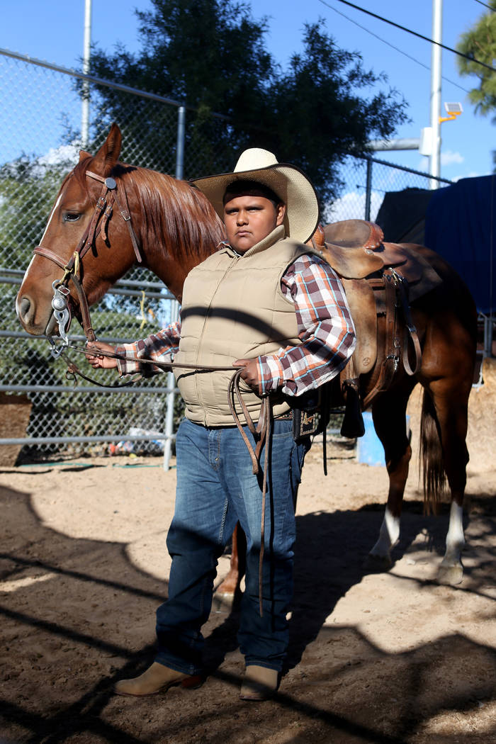 "Miguel Alamos, 13, with Rojo at Broadacres Marketplace in North Las Vegas, Sunday, Dec. 2, 2018. Alamos works at a booth simply called ""the ponies"" where $5 gets a child 5 minutes of rid ..."